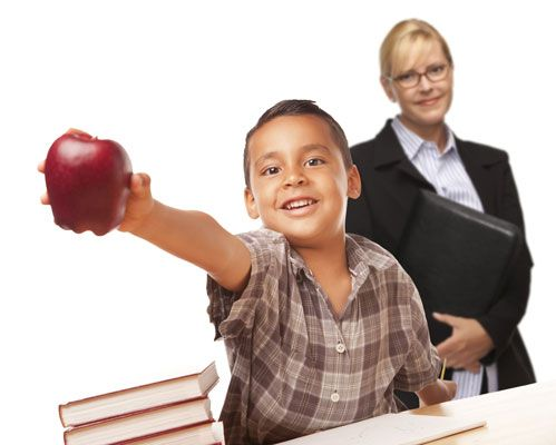Educational Staffing student with apple and teacher